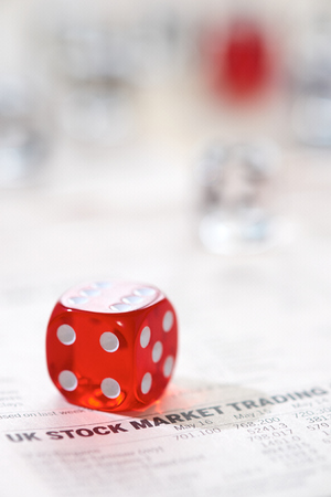 Stocks and shares Trading. Coloured dice stacked on the financial section of a newspaper. photo