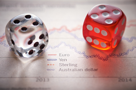 Stocks and shares Trading. Coloured dice on top of the financial section of a newspaper.