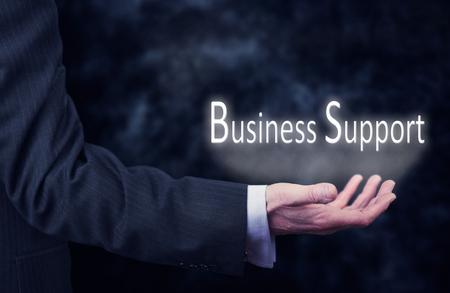 """business support: Een businessmans hand die de woorden, """"Business Support"""". Stockfoto"""