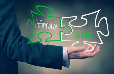 crime solving: A Businessmans hand holding the words Information Security.