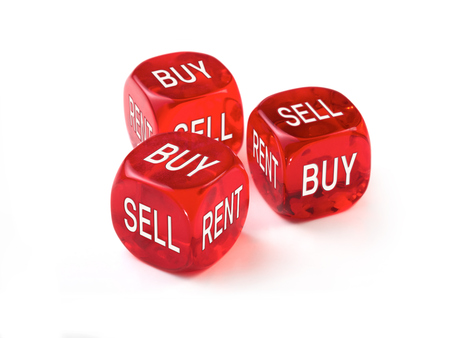 Housing market concept, three red dice on a White background. photo