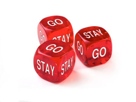 Go or Stay concept with three red dice on a white background. 版權商用圖片 - 29370841