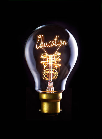 Good Education concept in a filament lightbulb. photo