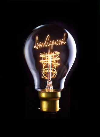 Loan Approval concept in a filament lightbulb. photo