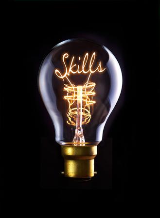 Skills concept in a filament lightbulb. photo