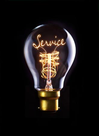 Customer Service concept in a filament lightbulb. photo