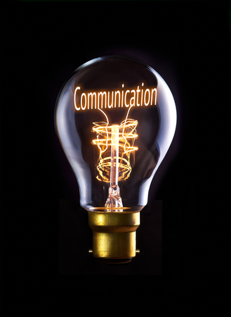 Good Communication concept in a filament lightbulb. photo
