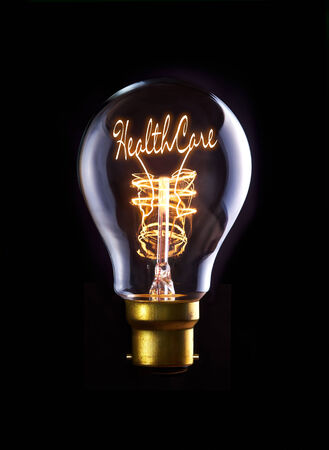 care providers: Good Healthcare concept in a filament lightbulb.