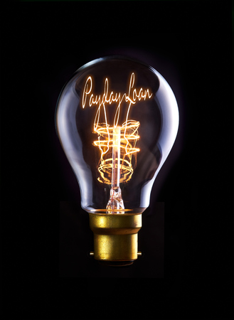 Payday Loan concept in a filament lightbulb. photo