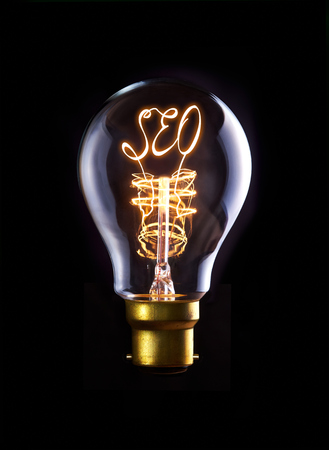 SEO concept in a filament lightbulb. photo
