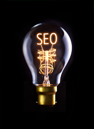 SEO concept in a filament lightbulb. photo