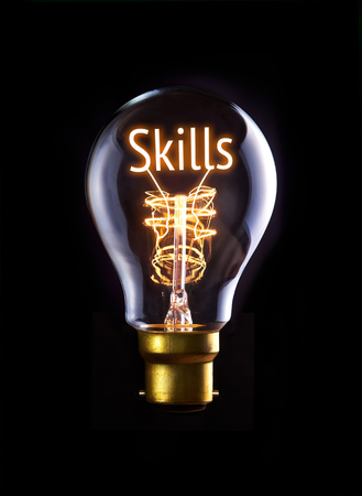 Skills concept in a filament lightbulb. photo