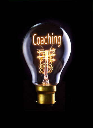 Coaching concept in a filament lightbulb. photo