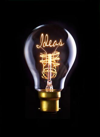 Ideas concept in a filament lightbulb. Imagens