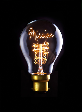 Missie-concept in een gloeidraad gloeilamp. Stockfoto