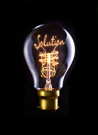 Solution concept in a filament lightbulb. Stock Photo