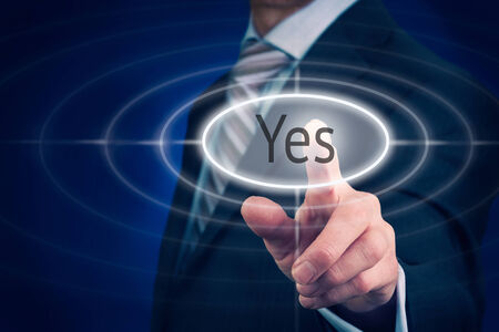 assertion: Businessman pressing a Yes concept button.