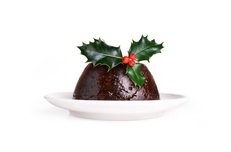 Christmas Pudding Witha Sprig Of Holly Isolated On A White Background. photo