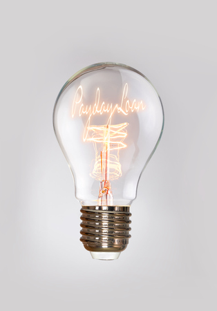 underwriter: Payday Loan concept in a filament lightbulb. Stock Photo