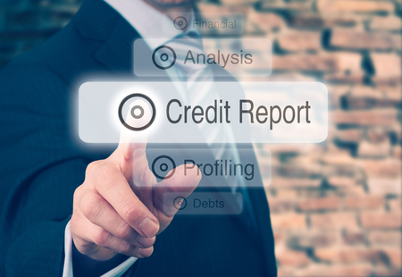 Businessman pressing a Credit Report concept button. Stockfoto