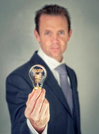 Education concept in a filament lightbulb. photo