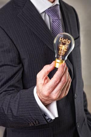 attain: Help concept in a filament lightbulb. Stock Photo