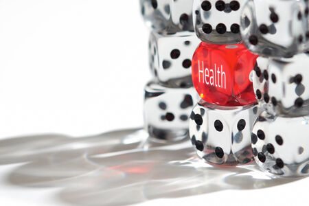 health care provider: Red Dice Standing out from the crowd, Good Healthcare concept. Stock Photo