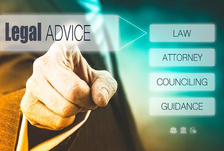 financial adviser: Businessman pressing a Legal Advice concept button. Stock Photo