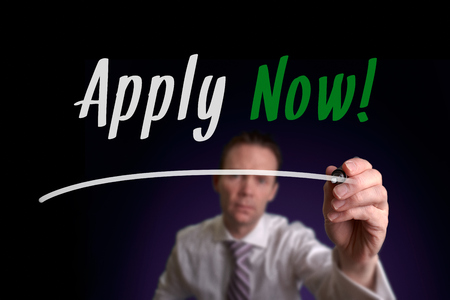 A businessman writing Apply Now on a screen. Business Concept.