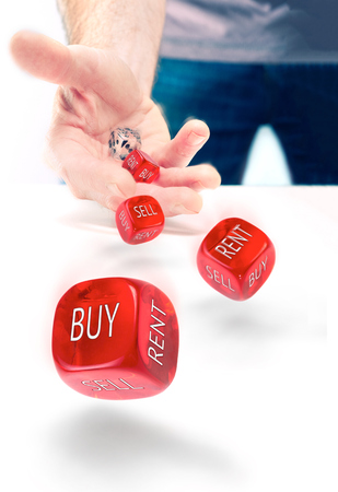 indecision: Buy vs Rent indecision, risk concept. Stock Photo