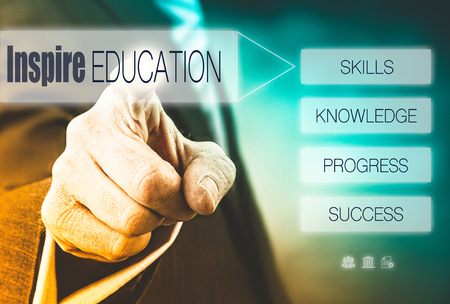 Businessman pressing a Good Education concept button. photo