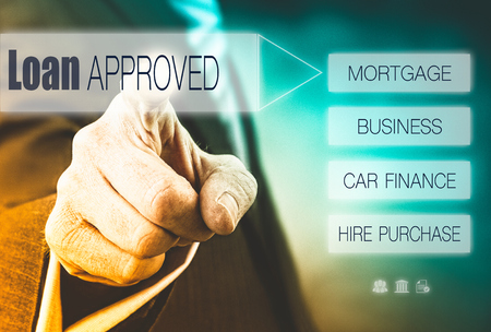 press agent: Businessman pressing a Loan Approved concept button.