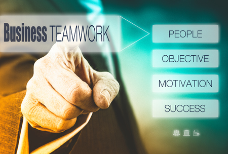 Businessman pressing a Teamwork concept button. photo