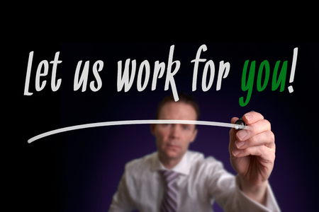 A businessman writing Let Us Work For You on a screen. Business Consultancy Concept.