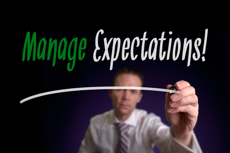 expectations: A businessman writing Manage Expectations on a screen. Business Concept.