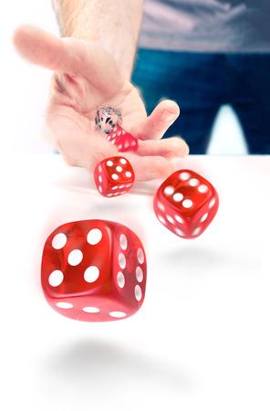 A closeup of a man throwing dice. photo
