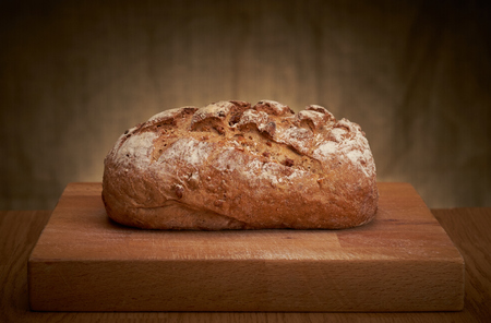 loaf: Freshly baked traditional bread on a table Stock Photo