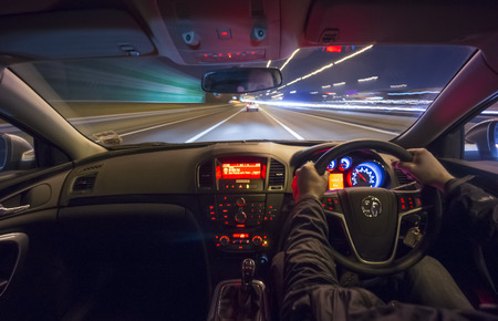 drives: Drving fast after a car on motorway at night.