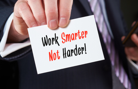 harder: A businessman holding a business card with the words,  Work Smarter Not Harder. Stock Photo