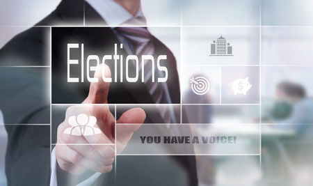 rhetorical: Businessman pressing an Election concept button.