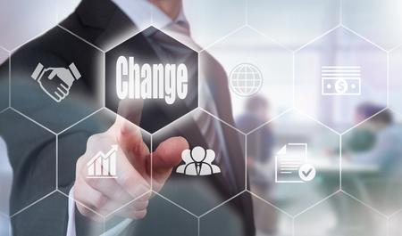 Businessman pressing a Change concept button.