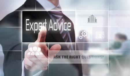 Businessman pressing an Expert Advice concept button. Stock Photo