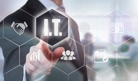 it: Businessman pressing an I.T. concept button.