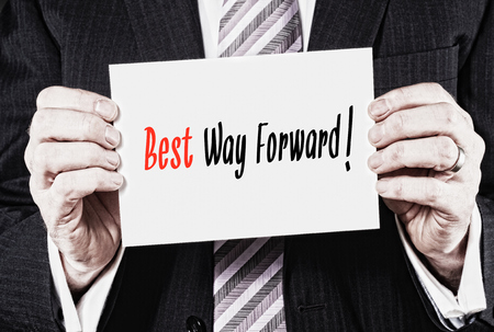 the way forward: A businessman holding a card with the words, Keep best way Forward. Stock Photo
