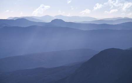 ridgeline: Cold pastel blue light over the the Scottish Highland mountains in autumn.