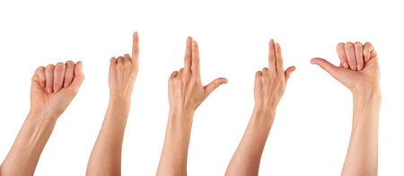 A collection of female hands pointing isolated on a white background. photo