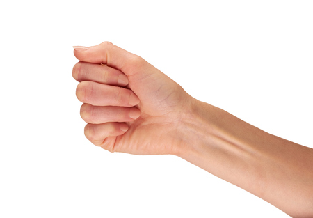 closed fist: A female hand outstretched holding isolated on a white background. Stock Photo