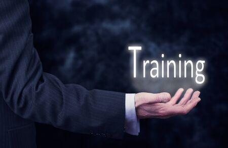leading education: The arm of a businessman holding the word Training.