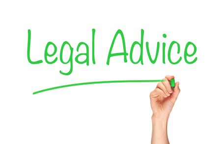 seeking assistance: A womans hand writing the word, Legal Advice, on a clear screen. Stock Photo