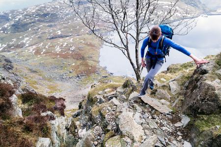 jacks: A hiker ascending Jacks Rake on Pavey Ark in the Lake District. Stock Photo